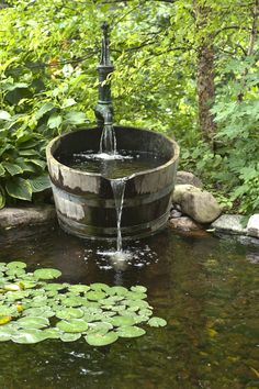 Your Dream Pond This whiskey barrel fountain adds an element of whimsy to this refreshing water garden.This whiskey barrel fountain adds an element of whimsy to this refreshing water garden. Design Fonte, Pond Fountains, Outdoor Fountains, Ponds Backyard, Backyard Waterfalls, Garden Ponds, Koi Ponds, Fountain Garden, Backyard Ideas