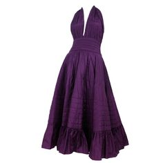 Laura Biagiotti quilted halter party dress in deep purple silk. Large ruffle hem | Italy, 1980's-1990's
