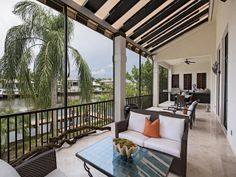 Lanai with striped awning - Aqualane Shores- 1889 4th St S, Naples, 34102