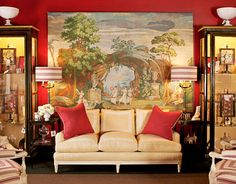couch in front of scenic wallpaper panel