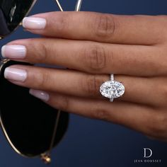 CHELSEA, platinum engagement ring, set with a 5 carat oval diamond, exclusively by Jean Dousset.