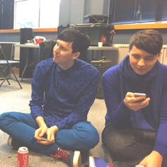 Dan and Phil :P I love how evan on brake after spending all day together they chose to sit together evan tho there is other friends and people there!!!!!!!