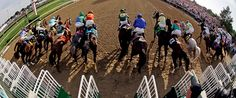 In a photo taken with a fish eye lens, horses leave the starting gate in the 138th Kentucky Derby horse race at Churchill Downs Saturday, May 5, 2012, in Louisville, Ky.  MATT SLOCUM - ASSOCIATED PRESS