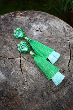 A personal favorite from my Etsy shop https://www.etsy.com/listing/549634508/ombre-emerald-layered-tassel-earrings