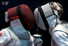 Tunisia's Boubakri competes against France's Guyart during their women's Individual Foil round of 16 fencing competition at the ExCel venue at the London 2012 Olympic Games. MAX ROSSI/REUTERS