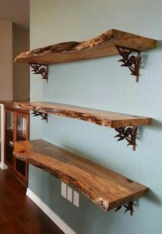 We used reclaimed maple slabs to create this wall shelving unit. After sanding and applying 5 coats of satin polyurethane ( 220 grit sanding between each coat), we attached the shelves to the wall using these beautiful purchased shelving brackets. Wood Shelf Brackets, Wood Shelves, Live Edge Shelves, Kitchen Shelves, Kitchen Wood, Dyi Bookshelves, Floating Shelves, Reclaimed Kitchen, Rustic Shelving