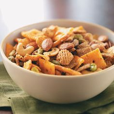 Kickin' Snack Mix - My favorite snack mix recipe!  ( I always leave out the pistachios and dill, cut the red pepper in half, and add extra cheese crackers :))