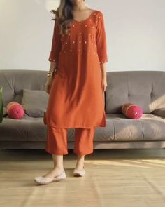Shop hand embroidered Rusty Brown straight kurta with ankle pants Online. Get Exciting Offers from Jovi Fashion Pakistani Fashion Casual, Indian Fashion Dresses, Dress Indian Style, Indian Designer Outfits, Pakistani Outfits, Indian Fashion Designers, Stylish Dresses For Girls, Stylish Dress Designs, Designs For Dresses