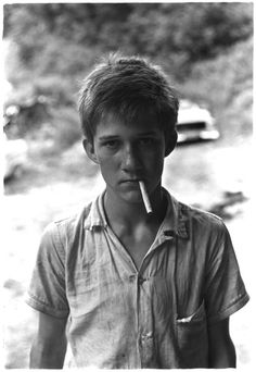 Teenage boy with cigarette hanging out of his mouth. Kentucky, 1964. William Gedney Photographs and Writings Duke University Rare Book, Manuscript, and Special Collections Library.