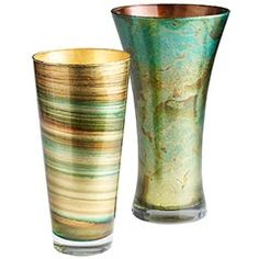 Crafted in Italy of mouth-blown glass, these vases are a beautiful mixture of shimmer and color.