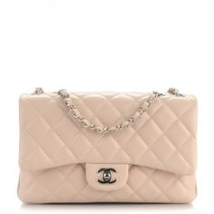 This is an authenticCHANEL Lambskin Quilted Medium 3 Flap inLight Pink. This classic shoulder flap bag is crafted of soft and supple diamond quilted lambskin leather in pink.