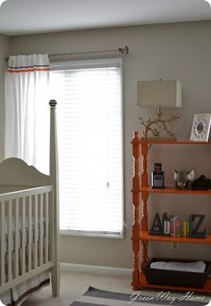Nursery  - I think I have this shelf in the sewing room. Look so much better orange than brown