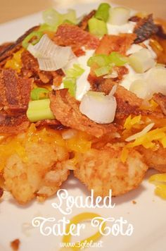 Loaded Tater Tots. Create this heap of awesomeness with tater tots, cheese, sour cream, bacon and green onions.  Great for a snack! #tatertots #loadedpotatoes www.3glol.net (scheduled via http://www.tailwindapp.com?utm_source=pinterest&utm_medium=twpin&utm_content=post1426731&utm_campaign=scheduler_attribution)