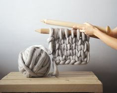 I'm just crazy about designer Anna Mo's über chunky blankets, scarves and rugs. Each of her snuggle worthy pieces are knit with Australian merino wool and giant knitting needles