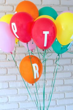 Gorgeously bright balloons with decal letters, surprise someone on their birthday with a balloon message from A Subtle Revelry.