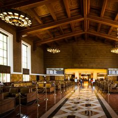 """The 11 Most Beautiful Train Stations Across America:Los Angeles Union Station Built in 1939, LA Union Station is hailed as """"the last grand railroad station built in America."""" An architectural hybrid of Art Deco, Spanish Colonial Revival, and Mission Revival styles, the interior's all multicolored tiles and terracotta tones, while the palm trees, fountains, and manicured gardens outside make the place look like a movie set. Which it's been. Perhaps you recognize it from Blade Runner?"""