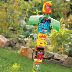 yard art - great way to recycle old tin cans totem poles