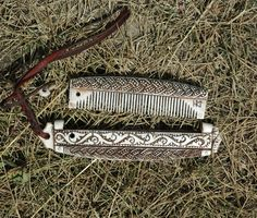 Grandma had a comb like this made of metal, but the comb itself was replaceable plastic.  Also, there was a mirror on one side.