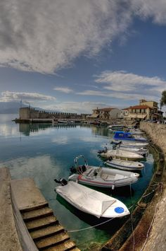 Several boats laying on the calm waters of Nafpaktos old harbour Old Harbour Nafpaktos Greece Oh The Places You'll Go, Places To Travel, Places To Visit, Myconos, Greece Islands, Greece Travel, Travel Europe, Beautiful Landscapes, Beautiful Places