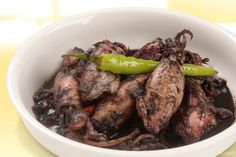 Adobong pusit is a squid dish cooked with the squid's ink, making the sauce black in color. This dish is similar to a Spanish squid dish that also uses the squid's black ink to make the sauce, so it may have been brought to the Philippines by the Spaniards during Spain's 300-year colonial rule of the Philippines.  Be sure to use fresh squid and cook it the same day it's brought home from the market.      [amd-zlrecipe-recipe:222]