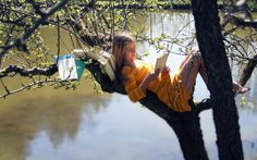 Girl on the tree, read books wallpaper 2560x1600
