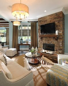 Corner Fireplace With TV Storage Design Ideas - need to keep in mind that if TV is mounted or stored above the fireplace, it will be higher than where it is currently.