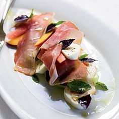 Melon-and-Peach Salad with Prosciutto and Mozzarella Recipe Appetizers, Salads with honeydew melon, peaches, extra-virgin olive oil, balsamic vinegar, salt, freshly ground pepper, basil, marjoram, fresh mozzarella, prosciutto