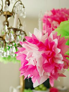 Tissue Pom Poms-These tissue paper pom-poms are inexpensive, but look impressive when hanging in groups from chandeliers or the ceiling. Tissue Pom Poms, Tissue Paper, Crepe Paper, Paper Poms, Paper Balls, Paper Paper, Pierre Decorative, Paper Crafts, Diy Crafts