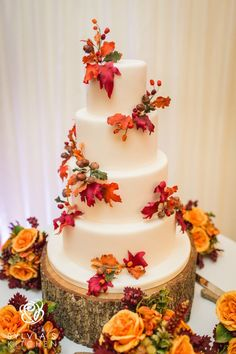 Four tiered wedding cake iced in pale ivory finished with sugar wired autumnal leaves, berries and acorns in golds, oranges, deep reds and browns wedding cakes cakes elegant cakes rustic cakes simple cakes unique cakes with flowers Autumn Wedding Cakes, Wedding Cake Rustic, Elegant Wedding, Orange Wedding Cakes, Halloween Wedding Cakes, Wedding Cakes With Cupcakes, Wedding Cake Toppers, Thanksgiving Wedding, Modern Cakes