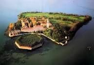 Pavoglia Island. Most haunted and evil place in the world. During the Roman times it was used to quarantine people due to the Bubonic Plague, and twice again later in history. During this time this small island saw 160,000 bodies. 50% of its soil is made of human Ashes. Later it was transformed into a mental hospital where one of the doctors went crazy and after butchering his patients, he threw himself from the bell tower located on the Island.