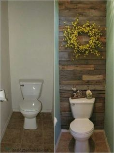 What a lux way to spruce up the small plain bathroom- minus the wreath- it would be perfect to add shelving.