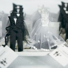 """These adorable Bride Dress and Groom Tux Favor Bags make an exceptional Favor """"Couple"""". In classic Black and White, they will complement any wedding color scheme. Shown here filled with white and blac"""