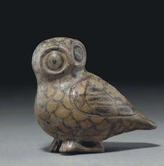 A CORINTHIAN POTTERY FIGURAL VASE ARCHAIC PERIOD, CIRCA 6TH CENTURY B.C.