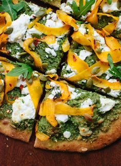 homemade pizza made with roasted butternut ribbons, homemade arugula-pepita pesto, goat cheese and a whole grain crust