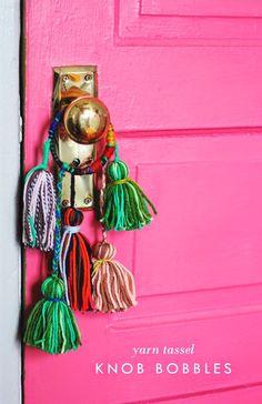 Yarn Tassel Knob Bobbles. Make a few simple yarn tassels and attach to an old bracelet, wrap with yarn. Bam! Instant bohemian.