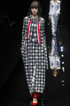 Giorgio Armani closed Milan Fashion Week with a playfully graceful show - and plaudits for dressing male and female stars for the Oscars.