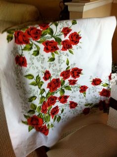 I have this somewhere from my mother. Vintage Tablecloth with Roses by Questers on Etsy, $32.00