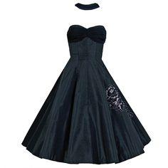 1stdibs.com | 1950's Seductive Black Silk Taffeta Shelf-Bust Halter Full Party Dress