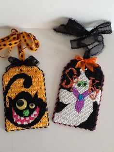 Like the google eyes. Halloween Gift tags by Renaissance Designs, needlepoint