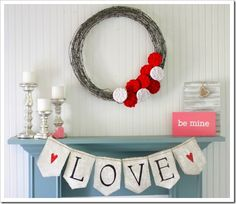 Barbed wire wreath with felt roses and mantle display for Valentine's Day... not too sure about the barbed wire, though