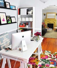 Colorful home office in white color with colorful floral rug