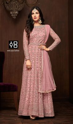 Bollywood diva sonal chauhan style pink anarkali suit online which is crafted from net fabric with exclusive zari embroidery and stone work. This stunning designer anarkali suit comes with satin bottom and chiffon dupatta. Designer Salwar Kameez, Designer Anarkali Dresses, Designer Gowns, Designer Wear, Latest Anarkali Suits, Bridal Anarkali Suits, Salwar Suits, Bridal Lehenga, Anarkali Gown