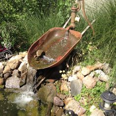 old pump and wheelbarrow create great water feature Backyard Water Feature, Ponds Backyard, Diy Water Feature, Backyard Ideas, Garden Fountains, Garden Pond, Outdoor Fountains, Pond Landscaping, Waterfall Landscaping