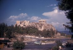1961 ~ Under the Acropolis, Dionyssiou Areopagitou street Greek History, Acropolis, Athens Greece, Places Ive Been, Taj Mahal, To Go, Country, Street, Building