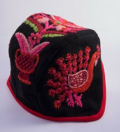 A small embroidered hat in Swedish Dala-Floda style