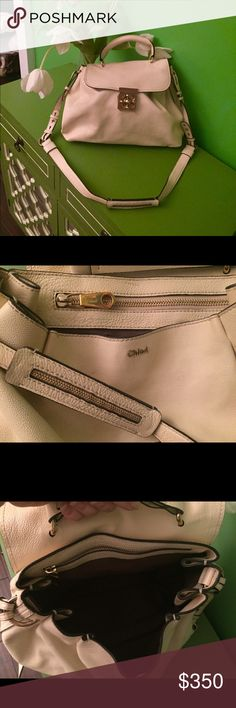 Chloe Elise medium crossbody bag All I can say is WOW! Authentic Chloe Elise medium crossbody bag in ivory/cream leather. What makes this bag so special is the gold turn lock detail in a flower pattern. Lots of attention to detail you love in a Chloe. Zipper detail throughout the crossbody strap. I love the hand stitching at the top of he bag that gives it the pleated look. Crossbody strap plus top handle. Gently used excellent condition. Only flaws are a few minor nicks on the leather, see…