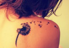 Tattoo next to tree that turns into birds with a person hanging on one if the dandelion thing