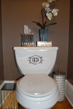 Monogram stickers on a toilet
