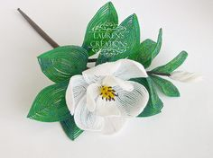 The newest addition to my custom beaded flowers - Southern Magnolia!   https://www.etsy.com/listing/218491415/french-beaded-southern-magnolia-flower