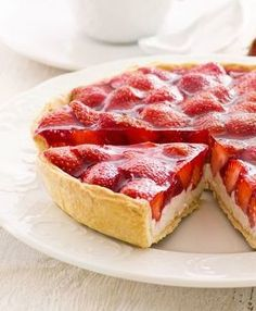 STRAWBERRY TART Yields 1 9-inch tart Ingredients Shell: 1 1/2 cups all-purpose flour 1 stick (1/2 cup) unsalted butter, cold, cubed 1/4 cup sugar 1/4 cup ice water 1 egg 1/4 teaspoon salt Filling: 2 pints strawberries, washed, hulled and halved 3/4 cup apricot jam, optional Pastry Cream: 4 extra-large egg yolks 1 1/4 cups milk, divided 1/2 cup sugar 3 tablespoons cornstarch 1 tablespoon heavy cream 1/2 teaspoon pure vanilla extract 1 pinch salt Directions Combine flour, sugar and salt...
